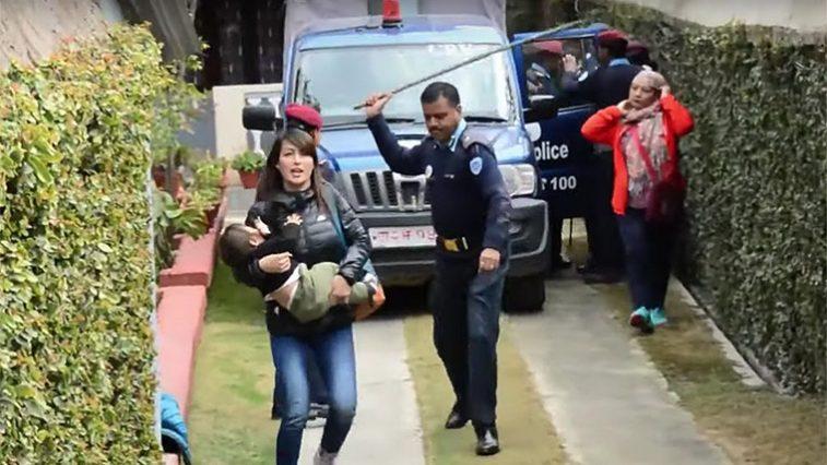 nepal police beats women carrying children 1