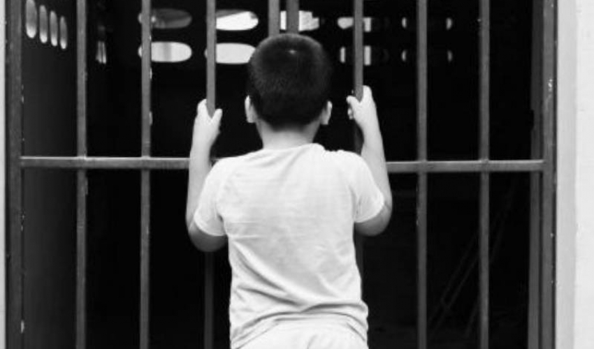 small boy in jail