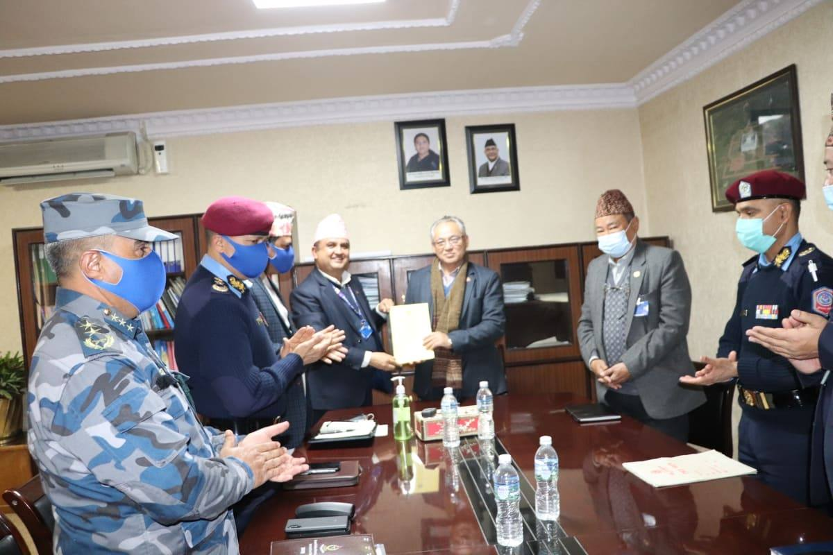 1613038228.Home Minister Ram Bahadur Thapa Badal with Nepal Police and Armed Police Force personnels