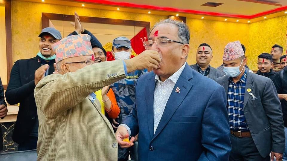 dahal and nepal sharing sweets 1