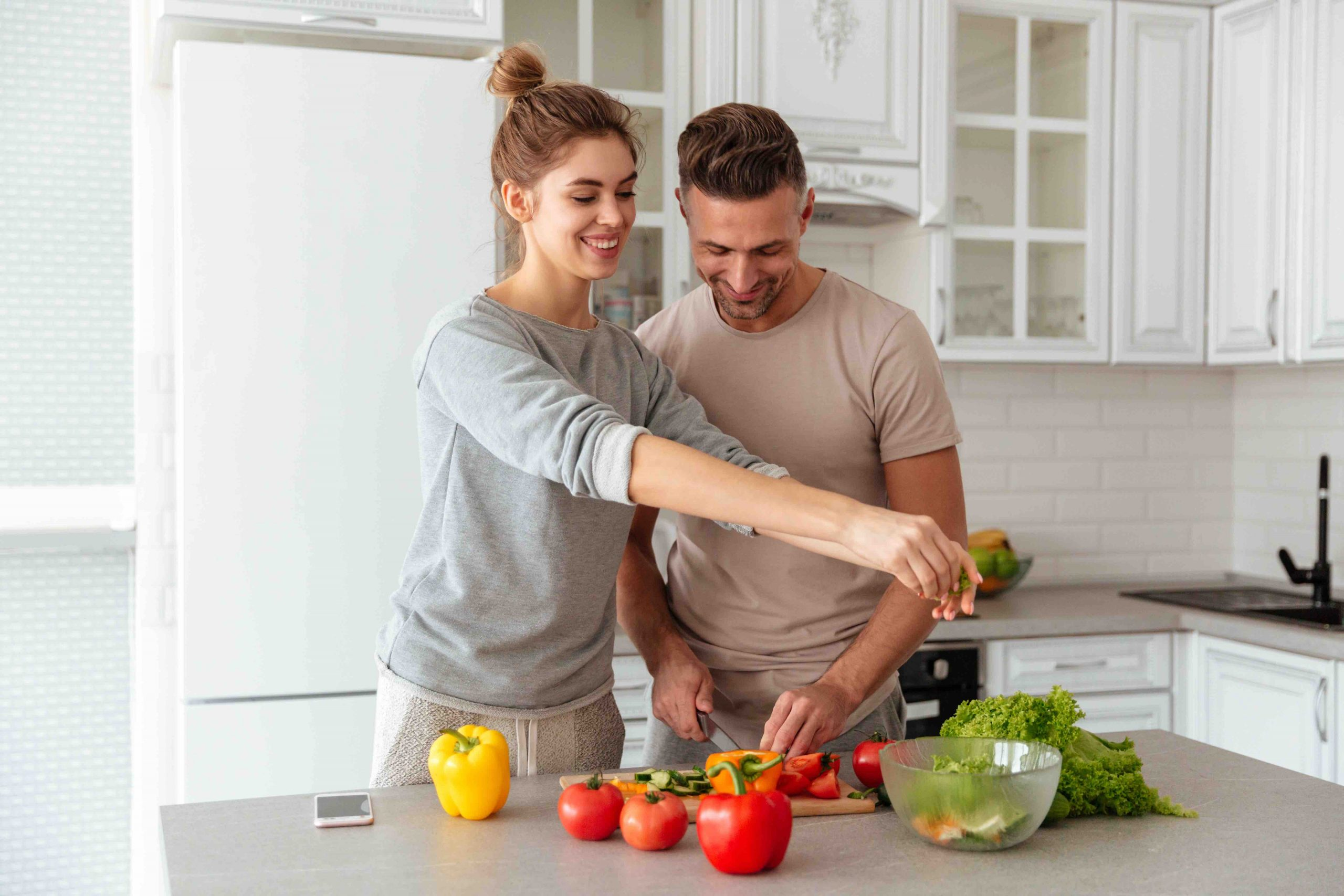 portrait cheerful loving couple cooking salad together scaled