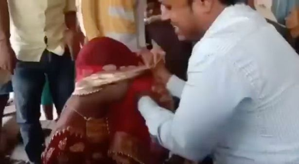 0 PAY Man dresses up as BRIDE to see his secret girlfriend on her WEDDING DAY and gets beaten up by gues