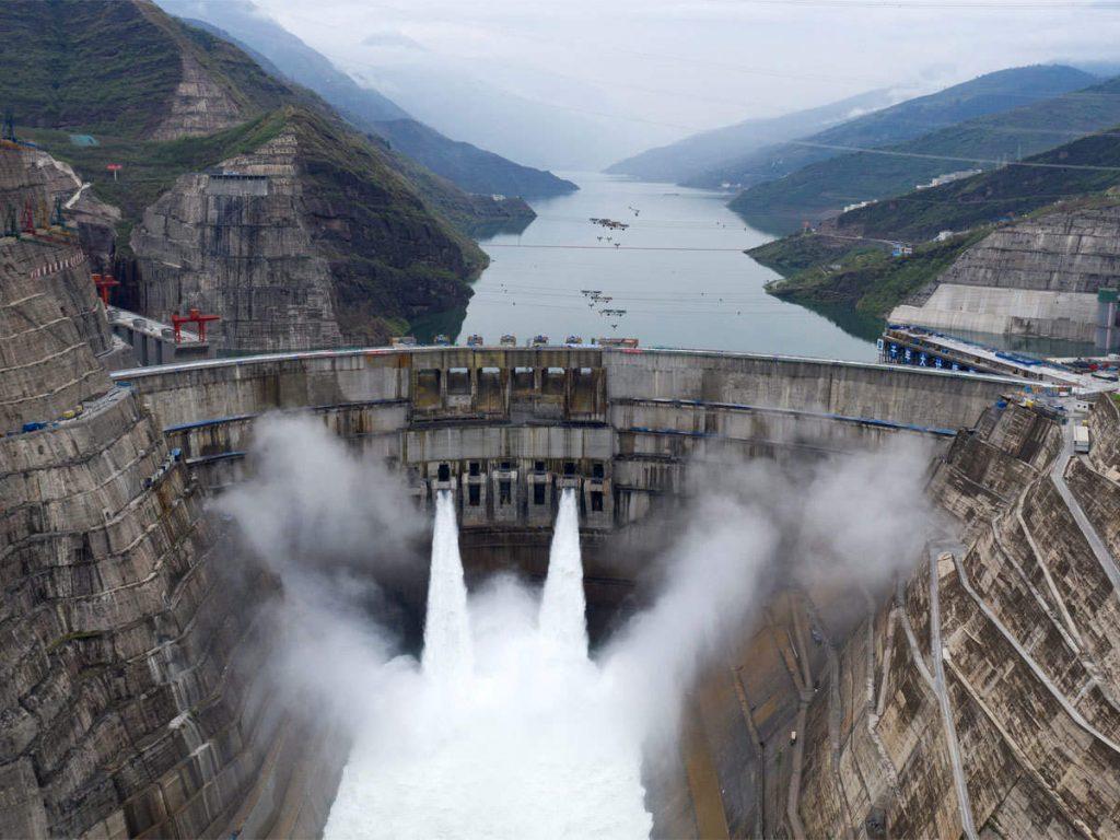china turns on worlds second biggest hydropower dam